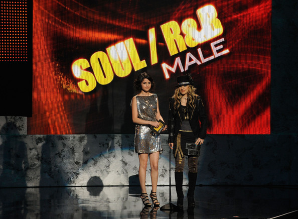 Selena Gomez Presenters (L) Selena Gomez and Orianthi onstage at the 2009 American Music Awards at Nokia Theatre L.A. Live on November 22, 2009 in Los Angeles, California.