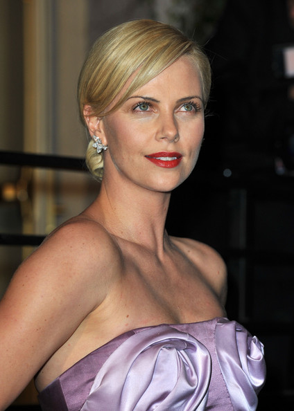 low bun hairstyles for prom. Charlize#39;s low chignon shows