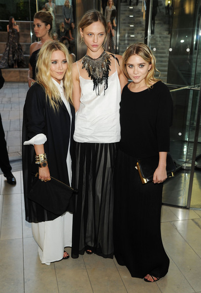 (L-R) Mary-Kate Olsen, model Sasha Pivovarova and Ashley Olsen attend the 2010 CFDA Fashion Awards at Alice Tully Hall, Lincoln Center on June 7, 2010 in New York City.