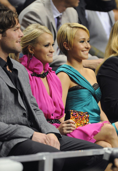Carrie Underwood Singer Carrie Underwood and actress Hayden Panettiere look on from the crowd at the 2010 CMT Music Awards at the Bridgestone Arena on June 9, 2010 in Nashville, Tennessee.