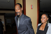 Rapper Snoop Dogg (L) and Shante Broadus arrive at the 25th Anniversary Of Cedars-Sinai Sports Spectacular held at the Hyatt Regency Century Plaza Hotel on May 23, 2010 in Los Angeles, California.
