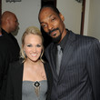 She gets hugs from Snoop Dogg.