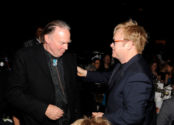 MusiCares Person of the Year Neil Young and  musician Elton John attend the 2010 MusiCares Person Of The Year Tribute To Neil Young at the Los Angeles Convention Center on January 29, 2010  in Los Angeles, California