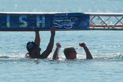 Chip Peterson (R) celebrates after winning the men's 10k open water final as second-place finisher Francis Crippen looks on during the Mutual of Omaha Pan Pacific Championships at Marine Stadium on August 22, 2010 in Long Beach, California.