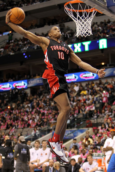 Demar Derozan DeMar DeRozan #10 of the Toronto Raptors shoots during the slam dunk contest at held at halftime during the T-Mobile Rookie Challenge & Youth Jam part of 2010 NBA All-Star Weekend at American Airlines Center on February 12, 2010 in Dallas, Texas. NOTE TO USER: User expressly acknowledges and agrees that, by downloading and or using this photograph, User is consenting to the terms and conditions of the Getty Images License Agreement.