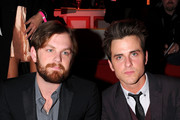 Musicians Caleb Followill and Jared Followill of Kings of Leon attend the 2010 Victoria's Secret Fashion Show at the Lexington Avenue Armory on November 10, 2010 in New York City.