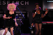 (L-R) Cyndi Lauper and Estelle perform onstage at the 2010 amfAR New York Inspiration Gala at The New York Public Library on June 3, 2010 in New York, New York.