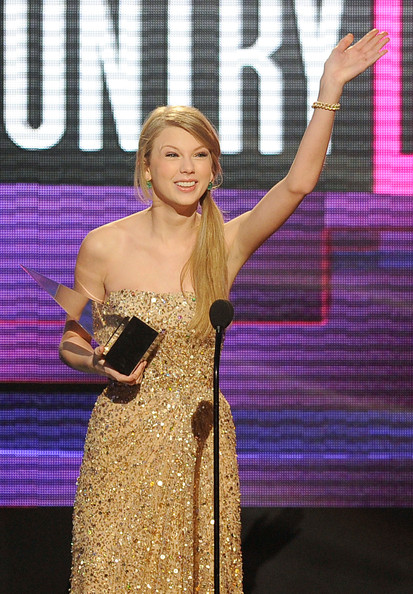 Singer Taylor Swift accepts Country Favorite Female Artist award onstage at the 2011 American Music Awards held at Nokia Theatre L.A. LIVE on November 20, 2011 in Los Angeles, California.