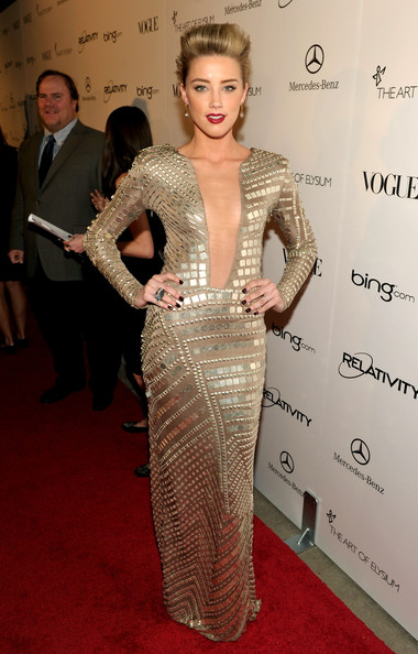 "Actress Amber Heard arrives at the 2011 Art Of Elysium ""Heaven"" Gala held at the California Science Center on January 15, 2011 in Los Angeles, California."
