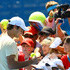 Roger Federer of Switzerland signs autographs for fans after a practice session during day seven of the 2011 Australian Open at Melbourne Park on January 23, 2011 in Melbourne, Australia.