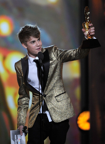 Singer Justin Bieber accepts the Digital Artist of the Year award onstage during the 2011 Billboard Music Awards at the MGM Grand Garden Arena May 22, 2011 in Las Vegas, Nevada.