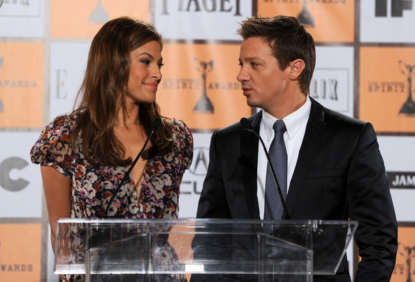 She takes the podium with Jeremy Renner.