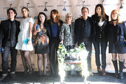 (L-R) Actor Thomas Ian Nicholas, actress Amanda Peet, actress Sarah Steele, director Nicole Holofcener, actress Ann Morgan Guilbert, actor Josh Pais, actress Catherine Keener, and casting director Jeanne McCarthy, winners of the Robert Altman award for 'Please Give', pose in the press room during the 2011 Film Independent Spirit Awards at Santa Monica Beach on February 26, 2011 in Santa Monica, California.