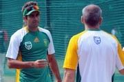 Imran Tahir (L) speaks to physiotherapist Brandon Jackson of South Africa during the South Africa national cricket team practice session at the PCA Stadium on March 01, 2011 in Mohali, India.