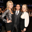He looks dapper with AJ and Aly Michalka.
