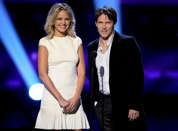 Actors Malin Akerman (L) and Stephen Moyer speak onstage during the 2011 People's Choice Awards at Nokia Theatre L.A. Live on January 5, 2011 in Los Angeles, California.