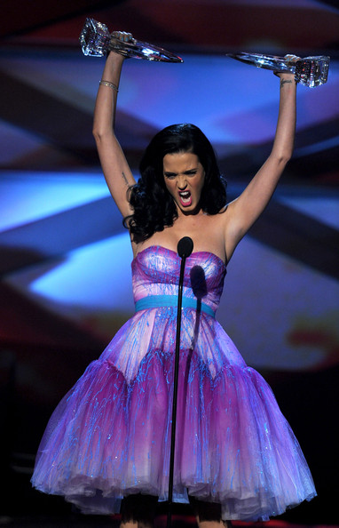 Singer Katy Perry aka Katy Brand accepts the Favorite Female Artist and Favorite Pop Artist awards onstage during the 2011 People's Choice Awards at Nokia Theatre L.A. Live on January 5, 2011 in Los Angeles, California.