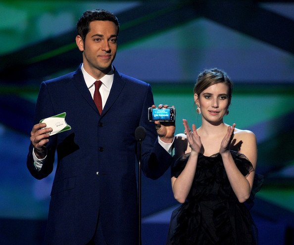 Actors Zachary Levi (L) and Emma Roberts speak onstage during the 2011 People's Choice Awards at Nokia Theatre L.A. Live on January 5, 2011 in Los Angeles, California.