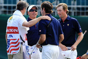 U.S. Team captain Fred Couples (2nd L) celebrates with Webb Simpson (R) and Bubba Watson of the U.S. Team (2nd R) on the 16th green during the Day One Foursome Matches of the 2011 Presidents Cup at Royal Melbourne Golf Course on November 17, 2011 in Melbourne, Australia.