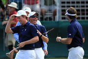 U.S. Team captain Fred Couples (C) celebrates with Webb Simpson (L) and Bubba Watson of the U.S. Team (R) on the 16th green during the Day One Foursome Matches of the 2011 Presidents Cup at Royal Melbourne Golf Course on November 17, 2011 in Melbourne, Australia.