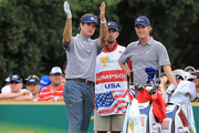 Bubba Watson of the U.S. Team talks with teammate Webb Simpson alongside Paul Tesori on the sixth tee during the Day Three Afternoon Four-Ball Matches of the 2011 Presidents Cup at Royal Melbourne Golf Course on November 19, 2011 in Melbourne, Australia.