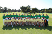 Members of the U.S. Team pose alongside their caddies and Golf Digest writer Bob Verdi during a practice round prior to the start of the 2011 Presidents Cup at Royal Melbourne Golf Course on November 15, 2011 in Melbourne, Australia.