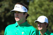 (L-R) Bubba Watson and Webb Simpson of the U.S. Team look on during a practice round prior to the start of the 2011 Presidents Cup at Royal Melbourne Golf Course on November 15, 2011 in Melbourne, Australia.