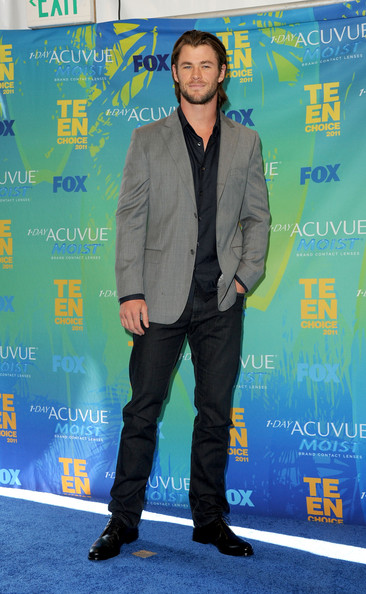 Actor Chris Hemsworth poses in the press room during the 2011 Teen Choice Awards held at the Gibson Amphitheatre on August 7, 2011 in Universal City, California.