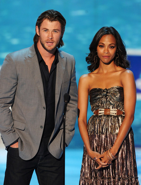 Actors Chris Hemsworth (L) and Zoe Saldana speak onstage during the 2011 Teen Choice Awards held at the Gibson Amphitheatre on August 7, 2011 in Universal City, California.