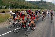 George Hincapie (second from left) and Chris Butler (third from left) of BMC Racing ride back down the hill with cycling fans after competing in the individual time trial during stage three of the 2011 USA Pro Cycling Challenge on August 25, 2011 in Vail, Colorado.