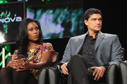 Actors Christine Adams (L) and Mido Hamada speaks onstage during the 'Terra Nova' panel at the FOX Broadcasting Company portion of the 2011 Winter TCA press tour held at the Langham Hotel  on January 11, 2011 in Pasadena, California.