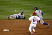 Elvis Andrus #1 of the Texas Rangers flips the ball to Ian Kinsler #5 for a fielders choice out to get Jaime Garcia #54 of the St. Louis Cardinals at second base to end the fifth inning during Game Two of the MLB World Series at Busch Stadium on October 20, 2011 in St Louis, Missouri.