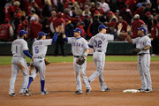 Elvis Andrus #1, Ian Kinsler #5, Michael Young #10, Josh Hamilton #32 and Adrian Beltre #29 of the Texas Rangers celebrate after defeating the St. Louis Cardinals 2-1  during Game Two of the MLB World Series at Busch Stadium on October 20, 2011 in St Louis, Missouri.