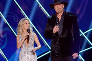 Hosts Kristin Chenoweth (L) and Trace Adkins speak onstage during the 2012 American Country Awards at the Mandalay Bay Events Center on December 10, 2012 in Las Vegas, Nevada.