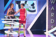 2012 HALO Award Honoree Allyson Ahlstrom and Actress Victoria Justice speak onstage at Nickelodeon's 2012 TeenNick HALO Awards at Hollywood Palladium on November 17, 2012 in Hollywood, California. The show premieres on Monday, November 19th, 8:00p.m. (ET) on Nick at Nite.