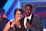 2012 HALO Award Honoree Allyson Ahlstrom and TeenNick Chairman and HALO Awards host Nick Cannon speak onstage at Nickelodeon's 2012 TeenNick HALO Awards at Hollywood Palladium on November 17, 2012 in Hollywood, California. The show premieres on Monday, November 19th, 8:00p.m. (ET) on Nick at Nite.