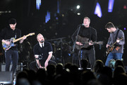 (L-R) Musician Jonny Buckland, Will Champion, Chris Martin, and Guy Berryman of the band Coldplay perform onstage at the 2012 MusiCares Person of the Year Tribute to Paul McCartney held at the Los Angeles Convention Center on February 10, 2012 in Los Angeles, California.