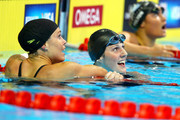 (L-R) Natalie Coughlin, Missy Franklin and Elizabeth Pelton react after they competed in the second semifinal heat of the Women's 100 m Backstroke during Day Two of the 2012 U.S. Olympic Swimming Team Trials at CenturyLink Center on June 26, 2012 in Omaha, Nebraska.