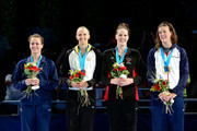 (L-R) Lauren Perdue, Dana Vollmer, Missy Franklin and Allison Schmitt celebrate as they are announced to represent the United States on the Freestyle Relay team for the 2012 London SUmmer Olympics  during Day Four of the 2012 U.S. Olympic Swimming Team Trials at CenturyLink Center on June 28, 2012 in Omaha, Nebraska.