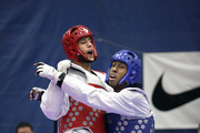 Mark Lopez (red) gets tangled up with Terrence Jennings(blue) during the 2012 Taekwondo Olympic Trials at the U.S. Olympic Training Center on March 10, 2012 in Colorado Springs, Colorado. Lopez won the match in overtime.