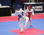 Terrence Jennings (red) squares off against Mark Lopez (left) in the second and deciding match in the 2012 Taekwondo Olympic Trials at the U.S. Olympic Training Center on March 10, 2012 in Colorado Springs, Colorado. Jennings won the second match 1-0.