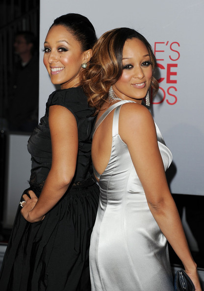 Actresses Tamera Mowry and Tia Mowry arrive at the 2012 People's Choice Awards held at Nokia Theatre L.A. Live on January 11, 2012 in Los Angeles, California.