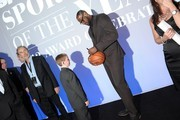 2012 Sportskid Conner Long and 2012 Sportsman of the Year LeBron James attend the 2012 Sports Illustrated Sportsman of the Year award presentation at Espace on December 5, 2012 in New York City.