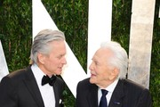 Actors Michael Douglas (L) and Kirk Douglas arrive at the 2012 Vanity Fair Oscar Party hosted by Graydon Carter at Sunset Tower on February 26, 2012 in West Hollywood, California.