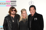 Singers Billy Ray Cyrus (L) and Wayne Newton (R) and Kathleen McCrone (C) attend the 2013 American Music Awards at Nokia Theatre L.A. Live on November 24, 2013 in Los Angeles, California.