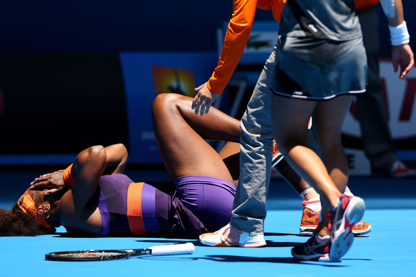 Serena Williams of the United States falls onto the court injuring her ankle in her first round match against Edina Gallovits-Hall of Romania during day two of the 2013 Australian Open at Melbourne Park on January 15, 2013 in Melbourne, Australia.