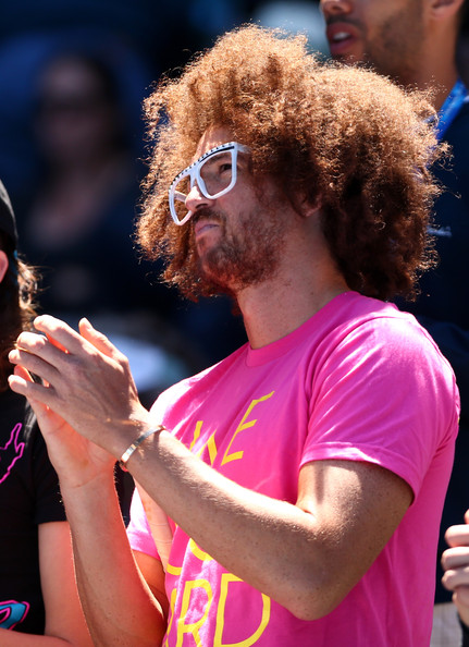 Redfoo from LMFAO watches Victoria Azarenka of Belarus and Jamie Hampton of the United States in their third round match against Jamie Hampton of the United States during day six of the 2013 Australian Open at Melbourne Park on January 19, 2013 in Melbourne, Australia.
