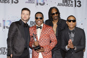 (L-R) Singer Justin Timberlake, BET Lifetime Achievement Award recipient musician Charlie Wilson, rapper Snoop Lion (formerly Snoop Dogg) and Pharrell Williams in the Backstage Winner's Room at Nokia Theatre L.A. Live on June 30, 2013 in Los Angeles, California.