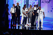 (L-R) Actors Duane Martin, Nick Cannon, JB Smoove, Boris Kodjoe, recording artist Nelly, comedian Kevin Hart, and recording artist Bobby Brown present an award to Jamie Foxx onstage during the 2013 BET Awards at Nokia Theatre L.A. Live on June 30, 2013 in Los Angeles, California.