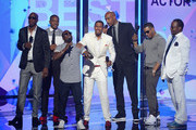 (L-R) Actors JB Smoove, Columbus Short, Kevin Hart, Nick Cannon,  Boris Kodjoe, Nelly, and Bobby Brown present an award onstage during the 2013 BET Awards at Nokia Theatre L.A. Live on June 30, 2013 in Los Angeles, California.